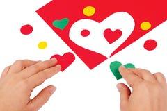 gröna röda handhjärtor för combine royaltyfri bild