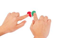 gröna röda handhjärtor för combine fotografering för bildbyråer