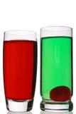 gröna röda shots arkivfoton