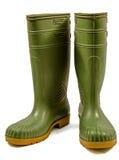Gröna rubber kängor Fotografering för Bildbyråer