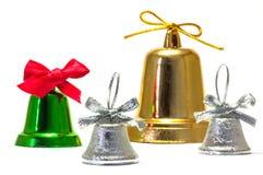 Gröna silver- och guldklockor med röd silver och den guld- pilbågen Fotografering för Bildbyråer