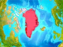 Grönland i rött på jord Arkivfoto