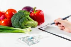 Grönsaken bantar näring eller medikamentbegrepp Royaltyfri Bild