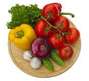 grönsaker för brädecuttinggrupp Arkivbild