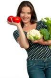 Grönsaker för Smilng kvinnaHolding Arkivbild