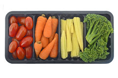 Grönsaker i den isolerade behållaren Arkivbild
