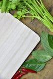 Grönsaker i tabell och sked Royaltyfri Fotografi