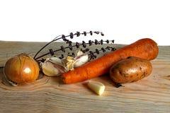 Grönsaker med filialerna av torr basilika Arkivbild