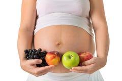Grönsaker och frukter under havandeskap Arkivfoto