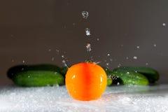Grönsaker och vatten Arkivbild