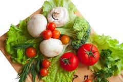 Grönsaker på wood bakgrund Arkivfoto
