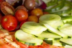 Grönsaker: tomater gurkor, peppar Arkivfoton