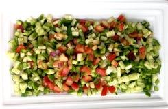 Grönsaksalladsnitt in i fyrkanter Arkivfoto
