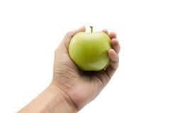 Grönt äpple i hand på isolerad bakgrund Royaltyfria Bilder
