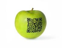 Grönt äpple och GR-kod Royaltyfri Fotografi