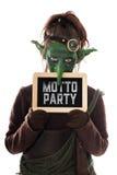 Grönt elakt troll som rymmer en slat med tysk text, temaparti Arkivfoton