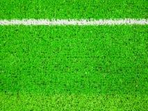 Grönt gräs med den vita linjen bakgrund fotografering för bildbyråer