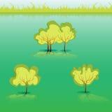 Grönt gräs och buskar och träd Royaltyfri Foto