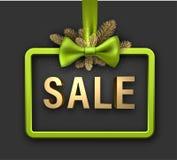 Grönt julförsäljningskort med pilbågen Royaltyfria Foton