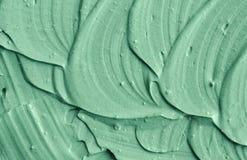 Grönt kosmetiskt leratexturslut upp Royaltyfria Bilder