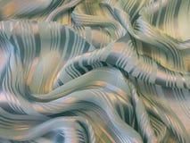 Grönt mjukt glänsande tygabstrakt begrepp Royaltyfria Bilder