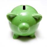 grönt piggy för grupp Fotografering för Bildbyråer