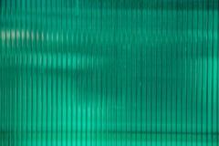Grönt plast- ark av polycarbonatematerial Royaltyfri Foto