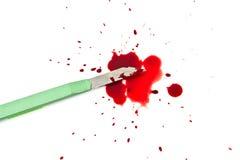 Grönt skärareknivar och blod Royaltyfri Bild
