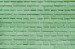 Grönt slut för tegelstenvägg upp royaltyfri bild