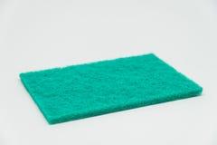 Grönt spola ren block med vit bakgrund och den selektiva fokusen Royaltyfri Foto