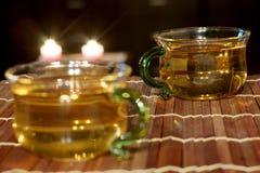 Grönt te i en glass kopp Arkivfoto