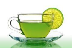 Grönt te med citronen på en vit bakgrund Fotografering för Bildbyråer
