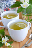 Grönt te med jasmin och citronen Arkivbild