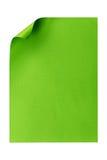 Grönt tomt pappers- som A4 isoleras på vit Arkivfoto