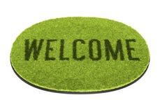 Grönt välkommet mattt Arkivbild