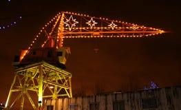 Grúa con las luces de la Navidad Fotografía de archivo