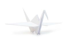 Grúa de Origami aislada sobre blanco Imagen de archivo