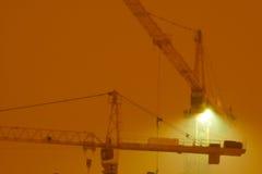 Grúas de Contruction en la noche Fotografía de archivo libre de regalías