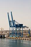 Grúas de la carga en el puerto del envío Imagen de archivo libre de regalías