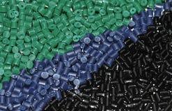 Grün-blau-schwarzer Plastik granuliert Lizenzfreies Stockfoto