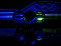Grün, blau und schwarz werden im mehrfachen Lensballs reflektiert stockbilder