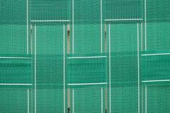 Grün gesponnenes Gartenstuhlgewebtes material Lizenzfreies Stockbild