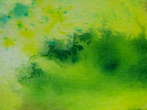 Grün mit gelben Aquarellen Stockfotografie