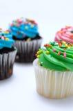 Grün und Blau-Ostern-Muffins mit besprüht Stockfoto