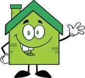 Grüne Öko-Haus-Zeichentrickfilm-Figur, die für den Gruß wellenartig bewegt Stockfoto
