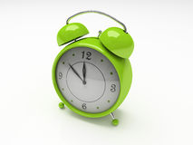 Grüne Alarmuhr getrennt auf weißem Hintergrund 3D Stockbilder