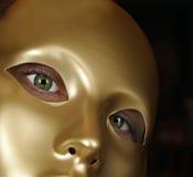 Grüne Augen und Goldschablone Stockbilder