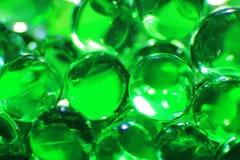 Grüne Bälle - Farbhintergrund - Fantasie und Bildschirmschoner der Schönheit Stockbilder