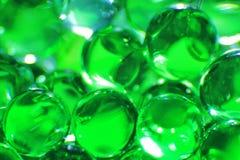 Grüne Bälle - Farbhintergrund - Fantasie und Bildschirmschoner des schönen Smaragds Stockfotografie