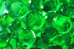 Grüne Bälle - Farbhintergrund - Licht und Schatten der Schönheit Lizenzfreie Stockfotos